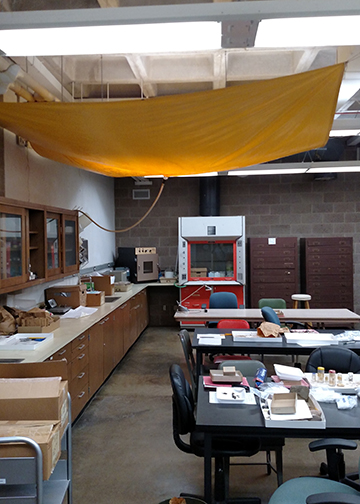 Archaeology lab protected from water by tarps and hoses