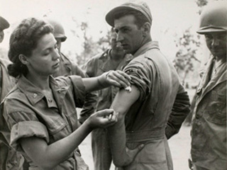 United States Army Nurse Corps Lieutenant Ernestine Koranda of Wadena, Minnesota giving injection to Sergeant James Visaki of Burlington, New Jersey in Queensland, Australia. Loc. no. E448.24 p10