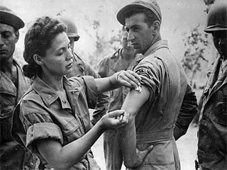 US Army Nurse Corps Lt.Ernestine Koranda of Wadena, MN giving injection to St. James Visaki, Queensland, Australia, 1943. Loc. no. E448.24 p10