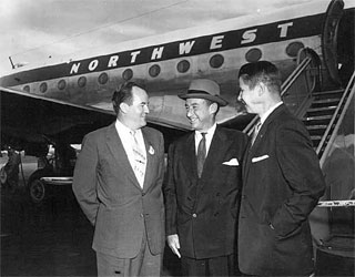 Photo: Hubert H. Humphrey, Adlai Stevenson, and Orville Freeman in front of a Northwest Airlines plane, 1959.