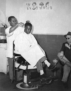 Photo: Sylvester Young, barber in shop owned by Walter Battle, Battle's Barber Shop, Sixth and Lyndale, Minneapolis, 1945-1950.