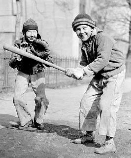 Photo: Young boy up to bat as catcher awaits the pitch, 1937.