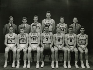 Charles M. Pearson (center), Captain of the Dartmouth College basketball team, 1942.