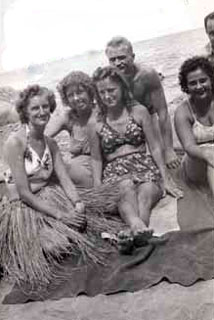 Jo Downey with friends on a beach in New Guinea, 1944.