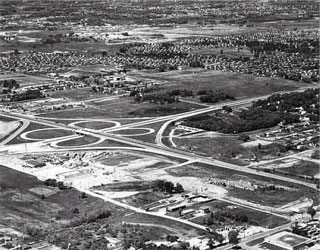 Photo: Aerial view of cloverleaf at intersection of I-35W and I-494 interchange in Bloomington, 1957.