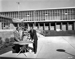 Men looking at blueprints, outside Bloomington High School, Bloomington, 1958.