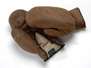 Brown leather boxing gloves, worn by North (Minneapolis) high school student, ca. 1930.