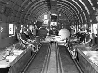 Photo: View inside the fuselage of a C-47 troop transport plane.