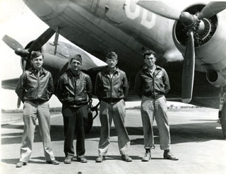 Photo: D-Day Crew – June 6, 1944.  L-R: Robert T. Carr, pilot; Paul Ducharme, co-pilot; Michael Farkas, crew chief; Kriser, radio operator.