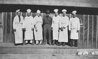 Cooks at Civilian Conservation Corps camp near Tofte, 1934.