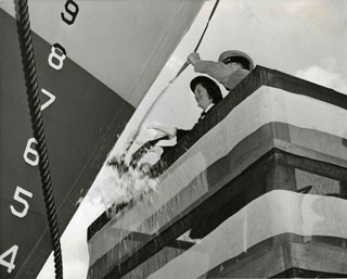 Photo: Elizabeth (B.J.) Hughs Gersey, christening the U.S.S. Passaconaway.