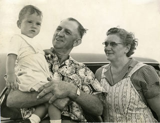Photo: Danny with his Grandpa and Grandma Cousins at their farm near Griswold, IA, 1954