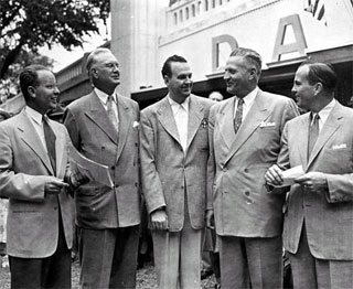 Photo: George Grim (left) with left to right: Harry A. Bullis, Gene Wilkey, Governor Luther Youngdahl and Donald C. Dayton, in front of Dayton's exhibit at the State Fairgrounds, 1950.
