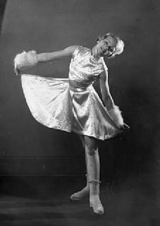 Dorothy Snell, aged 13, posed in figure skating costume, 1934.