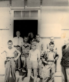 A group of recently released prisoners at Dachau, 1945.