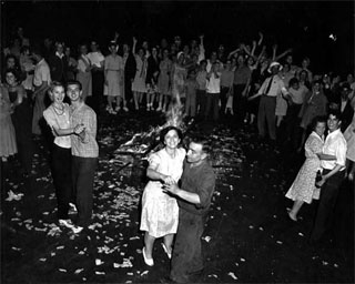 Couples dancing in the street on VJ Day, Minneapolis, August 1945.