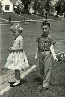 Photo: Danny Cousins, waiting for the school bus on the first day of school, 1958.