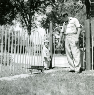 Photo: Bill Cameron with son, David John, in the family's yard in Luverne, June 1956.