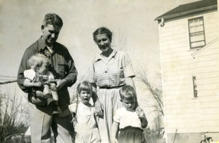 The Day family standing near their new home in Richfield, ca. 1949.