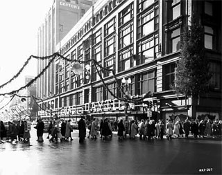 Christmas decorations on Nicollet Avenue in front of Dayton's, Minneapolis, 1954.