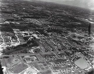 Photo: Edina, looking Northwest (Edina High School in lower left foreground and Lake Harvey (Highway 100) in lower right), Aerial, 1955.