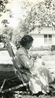 Emily Day feeding her youngest son, John, in the family's yard in Richfield, 1951.