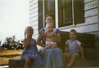 Photo: Emily Day, sitting on steps of Richfield home with her children, ca. 1949.