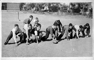 Boys playing football at Webster School, St. Paul, 1938.