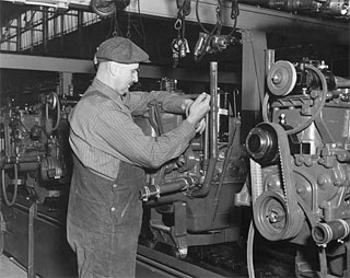 Photo: Henry Bergum assembling motors in the Ford war production plant, St. Paul.