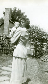 Carolyn Frederick holding baby daughter, Linda, May 1949.
