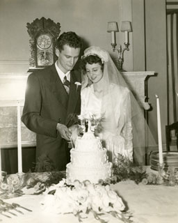 Don and Carolyn Frederick, cutting cake at their wedding reception, September 14, 1946.