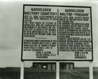 Sign erected by the 102nd Division at Gardelegen.