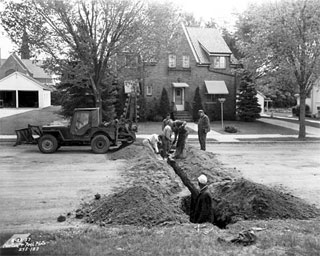 Photo: Working on gas line in a street in Rosemount, 1957.