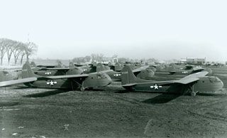 Photo: Minnesota-made CG-4A gliders ready for service lined up at Wold-Chamberlain Field in Minneapolis.