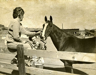 Dr. Bee Hanlon (holding Caesar) with Dr. Christine Gibbs, Radiologist at the University of Bristol, England at Terra Verde Stables in Montana, 1973.