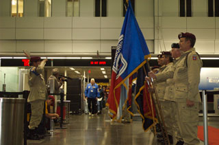 Photo: An Honor Guard was in place to greet the veterans returning home from Washington.