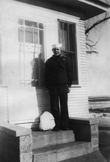 Lyman C. Irrgang home on leave from Navy boot camp, March 1941.