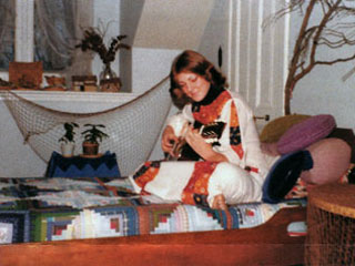 Jeannine Breton Baden with the quilt made by her mother, ca. 1976.