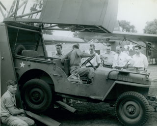 Photo: Unloading a jeep from a CG-4A glider. Image: Bruce Sifford Studio.
