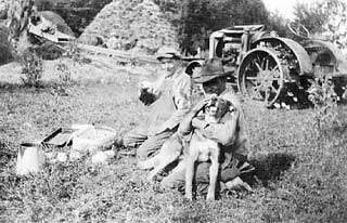 Lunch time during threshing, 1930.