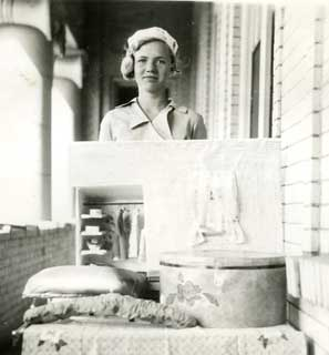 Mary Sjoberg with her exhibit and model of a closet, 1934.