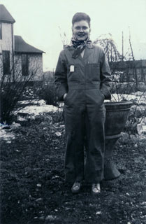 Millie Bowers decked out in worker's coveralls, ca. 1943.