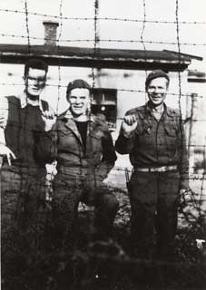 Don Frederick (left), with fellow prisoners, Moosburg POW Camp, Liberation Day, April 1945.