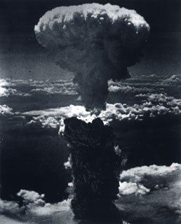 The mushroom cloud towering over Nagasaki, Japan following the dropping of the atomic bomb, August 9, 1945.