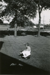 Photo: Mary Maxson, reading a book in the family's spacious backyard in Richfield, 1943.