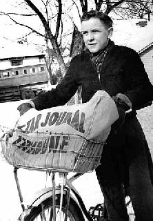 Minneapolis paper carrier with bike, 1938.