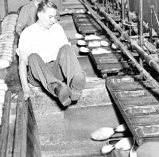 Pinsetters at work at Midway alleys, 1937.