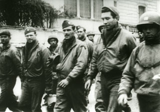Photo: American POWs being marched through the streets of Rome by German captors, [1944?].