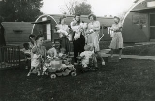 "Lee Sworsky (seated, second from left) with her twins and the Buchanan Street ""Quonset Gang"", 1947."