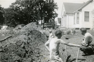 Digging a drain field in the Maxson's yard, Richfield, 1944.